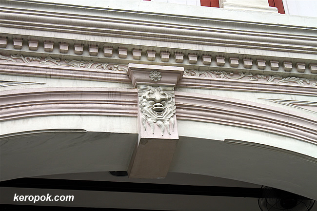 faces on building
