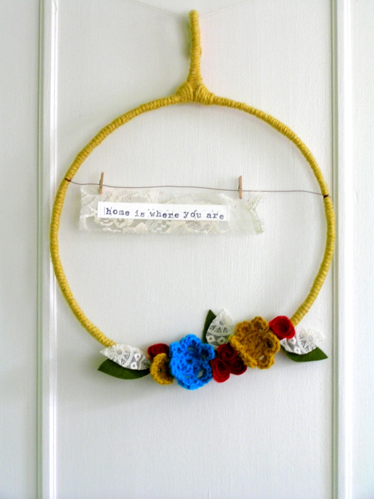 home is where you are - yarn wreath in mustard, red, turquoise, and ivory