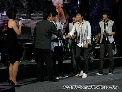 Receiving an award from the K-Box boss