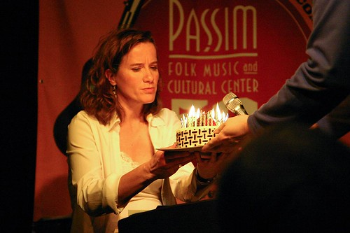 Susan Werner with birthday cake, Club Passim, April 2, 2009