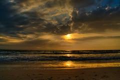 St Pete Beach at Sunset (thephotographymuse) Tags: ocean sunset sea vacation sun seascape beach water clouds sand view florida rays sunrays hdr 44 sunray stpetebeach rayoflight oceanic magicdonkey explored fineartphotos magicdonkeysbest goldenheartaward