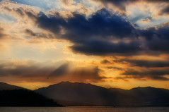 Epiphany (kristian.eric) Tags: light sunset shadow sea mountain beach nature silhouette clouds landscape nikon rays cloudscape d90 supershot 18105mm isawyoufirst kristianm