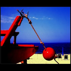 RED Lifeguard (Osvaldo_Zoom) Tags: red sea italy rescue beach lifeguard moscone marche baywatch adriatic pedalo