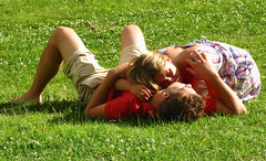 Young Couple Under the Sun (Jim Boud) Tags: park england london love canon couple younglove iloveyou youngcouple inlove snuggling coupleinlove jimboud layingonthegrass jrbxom jamesboudphotoart