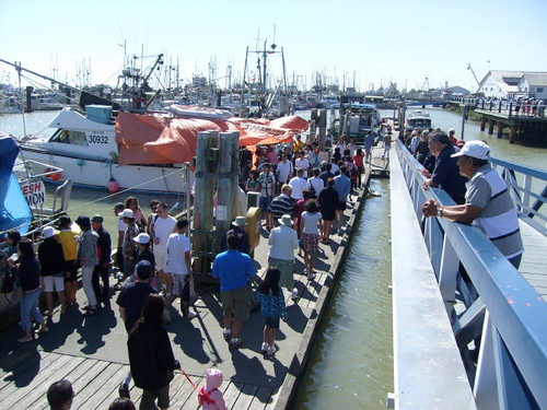 Boats docked at the Steveston wharf sell freshly-caught fish and seafood