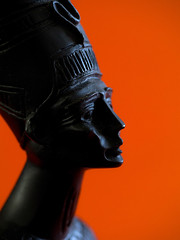 Hand carved bust - Queen Nefertiti of Egypt? (fstop186) Tags: leica sunset portrait orange sun macro art history beautiful face statue lady sunrise mouth neck nose lumix wooden carved eyes ancient worship symbol background religion egypt royal craft icon grace historic queen bust ornament cult crown local ornate sungod rare 45mm pharoah aten artisan nefertiti hieroglyphics ancientegypt elmarit mft sundisc armana beautifulone microfourthirds micro43rds leicadgmacroelmarit45f28 panasonicdmcg3