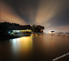 Drama In the Dark ;o) (Ragstatic) Tags: city longexposure morning travel light sunset sea sky people sun seascape color reflection tourism beach water clouds sunrise relax landscape happy dawn lights photo google search nikon singapore rocks asia exposure view nocturnal nightshot rags famous culture visit tourist calm explore photograph destination serene nocturne dri hdr stockphoto blending d700 singaporelandscape singaporenightshot singaporeview singaporeseascape singaporetourist