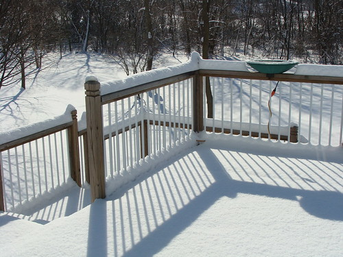 Sun and snow on the deck by ggaippe