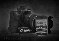 I can't live without them.. (uis) Tags: bw white black canon eos flickr blackberry s bold bbb 24105mm 50d alkubaisi