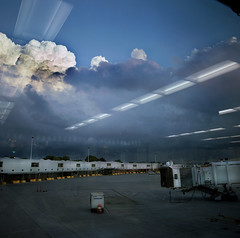 2008_070_010 (chuckp) Tags: sunset reflection clouds dark truth colorado slow denver terminal airports jetway trial fullsize alltime distagon lpv wnwreflections alanshasselblad lpvint