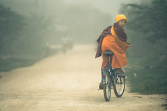 looking back (tomms) Tags: morning bike fog southeastasia village buddhist monk buddhism save cycle dirtroad laos novice muangsing happybirthdayblursurfing beaterbikeblogto