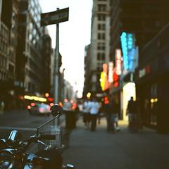 City Lights (Inside_man) Tags: people newyork 120 6x6 tlr film colors facade mediumformat neon minolta bokeh manhattan citylife chrome citylights signage motorcycle headlight taillight autocord portravc minoltaautocord hbw bokehlicious