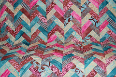 BatikBraid (ReannaLilyDesigns) Tags: pink blue brown stripes howto instructions tutorial batik scrappy jellyroll quilttop freepattern lapquilt reannalilydesigns braidedquilt