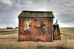Shed 1 (kell_2611) Tags: wood winter sea sky orange beach metal clouds canon boat town kent fishing sand stones railway burnt dungeness material headland hdrphotography dungenesskent nucleapowerstation oldmetalshed