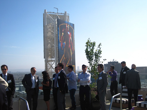 Guests on the rooftop of the W, dwarfed by an Iron Man 2 supergraphic advertisemnt.