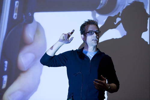 Renny standing in front of a picture of the CellScope during his 2010 WebVisions talk