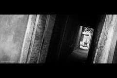 Altars and Alleyways (Doug Mo (Gone Vagabonding)) Tags: nepal light blackandwhite bw brick dark blackwhite asia cement entrance altar doorway alleyway miscellaneous hinduism patan hdr highdynamicrange 2010 entranceway kathmanduvalley photomatix lalitpur 1239 photomatixpro adobelightroom exposurefusion photomatixpro4 adobelightroom3 fusedexposure lrmogrify2