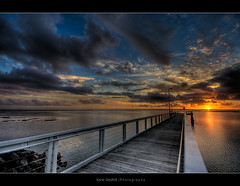 Lucky man ([ Kane ]) Tags: light shadow cloud sun water clouds sunrise reflections dawn pier rocks shaddow brisbane explore qld rays kane wellingtonpoint gledhill aplusphoto kanegledhill 12thjan09 kanegledhillphotography