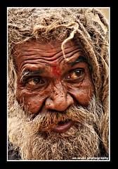 sadhu baba (aruni sg) Tags: old portrait brown india man eye art history smile canon dream wb drama pure kolkata blueribbonwinner golddragon abigfave anawesomeshot impressedbeauty canon450d superbmasterpiece flickraward ysplix theunforgettablepictures goldstaraward aruniphotography