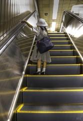 Metro girl (maciej.ka) Tags: girl japan metal subway tokyo alone metro small escalator tube x   japon maciej maciek japani tokio jepang japn   japonya japoni kielan bn nht jaapan japn japonsko    fotocompetition fotocompetitionbronze polandphotography emkej maciekk