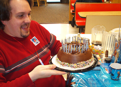 Tom stares in disbelief at the 30 candles he blew out on his cake