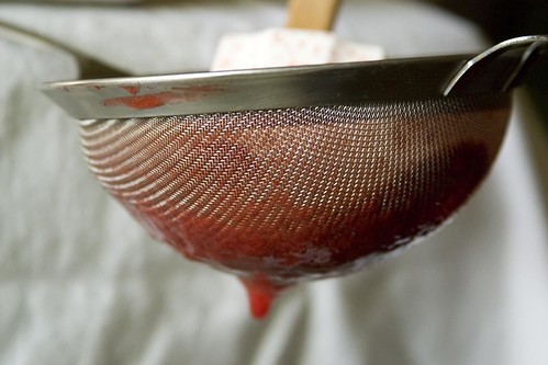 Straining strawberry puree