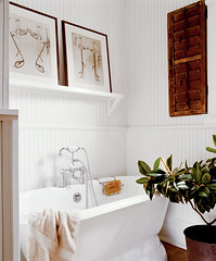 Classic white bathroom + striped wallpaper + wood accents (xJavierx) Tags: wood wallpaper white plant art tile bathroom design framedart interior shelf clean coastal decorating shutter tropical bathtub nautical decor beachy ralphlauren potterybarn behr beadboard wainscoting coastalliving stripedwallpaper bathroomwallpaper