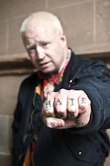 Gordon, Manchester, 19 June, 2009 (Dr John2005) Tags: uk england tattoo writing manchester unitedkingdom text fist hate skinhead