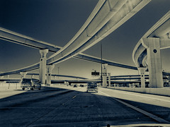 I live near this mess... (matt.harding) Tags: bw cars canon texas houston overpass bowl freeway trucks spaghetti i10 toned fromcar lanes g11 beltway8 throughtthewindshield
