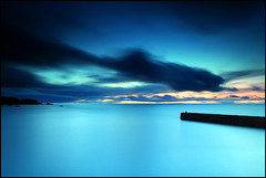 Distant shores (angus clyne) Tags: life blue winter sunset shadow red sea wild orange cloud sun storm haven west reflection bird home rain rock easter island gold islands coast long exposure ship shine bright wind harbour dusk south north under deep scottish wave windy stormy tunnel spray east shore hour land cave setting surge swell channel firth gloaming clow portknockie nuek colorphotoaward getofmycloud