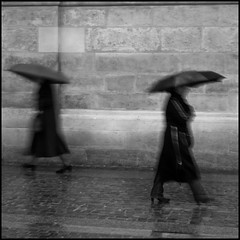 Dancing in the rain - Paris (Gwen Lafage) Tags: street bw white black paris rain noir pluie rue blanc parapluie ombrella artlibres  masterpiecesoflightdark yourbestblackandwhite