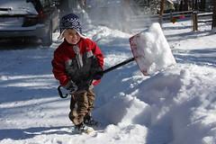 Austin shoveling snow