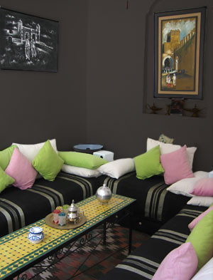 The drama shot-dark chocolate takes this nook from day to night. Notice how the colorful pillows pop like candies.