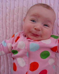 Awwww Shucks (tumultuouswoman) Tags: old pink baby 3 silly cute feet girl face up smiling laughing nose happy hope kid eyes infant child close mommy joy mother adorable happiness mama stretch polka polkadots flirting blanket knees dots squish ever month cooing