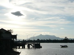 Kuching, City of Cats #29  A Boat Departs The Jetty. (ighosts) Tags: sunset sky cloud love water river ruins couples esplanade kuching eastmalaysia bronzecrocodile