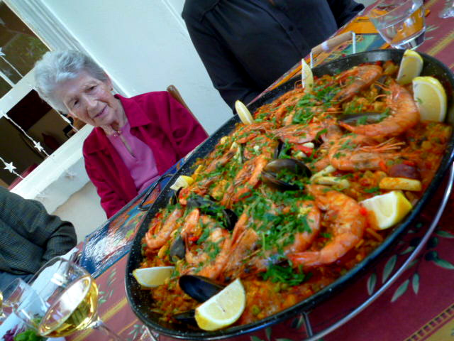 Nonna inspecting the paella