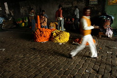 ... in motion | Kolkata (arnabchat) Tags: street bridge people india motion blur flower moving dynamic market cobbled marigold favs kolkata bengal calcutta bangla customers sellers westbengal canon400d arnabchat mullickghat arnabchatterjee mullickghatflowermarket