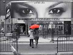 Red`fc (roll the dice) Tags: street uk red people urban blackandwhite london eye art classic westminster face look fashion umbrella advertising french photography clothing women crossing cone candid strangers style stranger unknown coventgarden cosmetics fcuk unaware selective adverts wc2 frenchconnection londonist