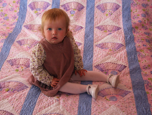 Nora on her quilt