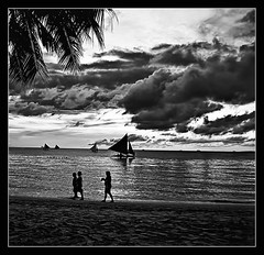 the calm before the storm (PNike (Prashanth Naik)) Tags: sunset sea sky people bw storm water silhouette clouds dark blackwhite nikon sailing philippines calm coconuttree boracay sailboats stormclouds boracayisland pnike