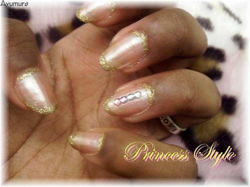 nail Princess style with jewels nails design pink nail polish with small specks of glitter in it and a glittery polish to make the stripes. nail art designs gallery