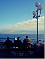 Sit and wait (Madame Eleonora) Tags: sea italy reflection lamp bench italia mare sitting liguria lampione riflesso anziani panchina bordighera pozzanghera seduti santampelio