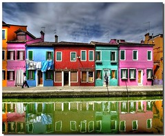 Walking among the colors (Nespyxel) Tags: travel houses windows italy holiday colors reflections walking vivid case colori riflessi isle burano isola finestre reflexes veneto nespyxel stefanoscarselli 3onthelist0030 pleasedontusethisimageonwebsites blogsorothermediawithoutmyexplicitpermissionallrightsreserved