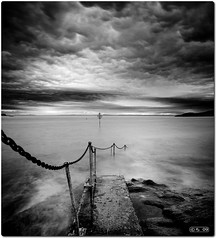 Old Pier ([c-h-i]) Tags: old sea sky bw metal stone clouds pier nikon rocks long exposure waves north steps rail chain chi berwick 28200mm f3556d nd110 vertorama