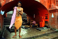 time for a bath | Kolkata (arnabchat) Tags: red people india man wet dark bath arch massage hanuman bengal preparation bangla moist westbengal maalish ghaat duallight canon400d babughat arnabchat arnabchatterjee