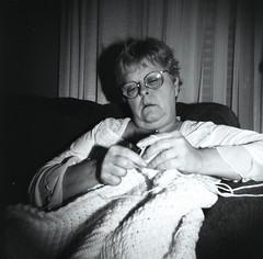 Knitting a Blanket (Bowman!) Tags: woman delete10 delete9 mom delete5 delete2 glasses holga lomo hands knitting delete6 delete7 knit save3 delete8 delete3 delete delete4 save save2 yarn save4 delete11 lomographics blackandwhiteilford