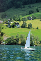 Lucern Sailing (cwgoodroe) Tags: sun mountain lake snow alps green church statue ferry fairytale swimming switzerland boat europe locals suisse swiss sunny location farms movieset luce swissalps lucern medivil beerpasture