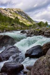 Rocky Rapids (Jim Boud) Tags: longexposure mountains nature norway clouds digital canon river eos rebel stream smooth rocky rapids valley soe silky xsi 450d jimboud topazadjust jrbxom jamesphotoart