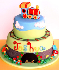 Train Cake...... (~Trs Chic Cupcakes by ShamsD~) Tags: flowers cute colors beautiful cake clouds train butterfly stars southafrica mushrooms nikon colours gorgeous tunnel railwaytrack fondant pietermaritzburg gumpaste 5yearold choochootrain chocolatemudcake whitechocolatemudcake noveltycake shamsd proudlysouthafrica shamimadesai madeinsouthafrica mousellinebuttercream cakesfromsouthafrica cakesinpietermaritzburg