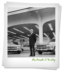 Mr Frank O'Rielly in front of new store, 1966